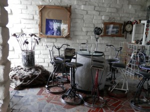 A great use of clutter; re-purpose your collection. This man recycled parts of bicycles to make bar stools.